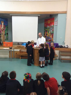 Baptism role play with father Paul 1